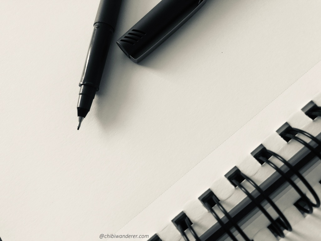 a pen and a blank paper